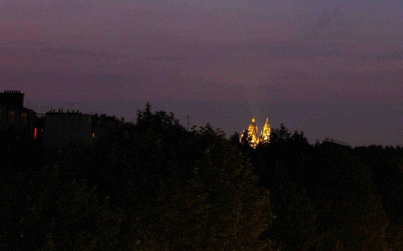 Sacré-Coeur in the distance at night